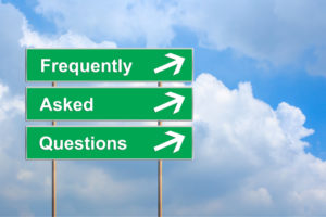 FAQ or Frequently asked questions on green road sign with blue sky